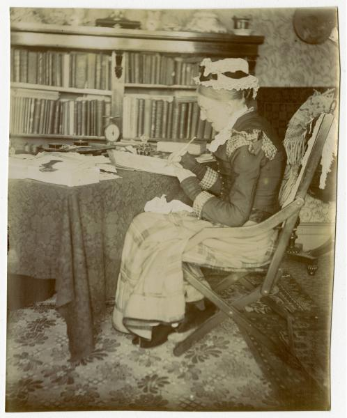 Catherine C. Hopley at desk