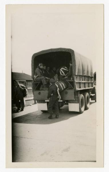 Army Air Forces members loading a transport vehicle
