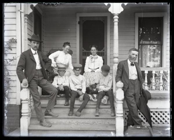 Family on front porch photograph