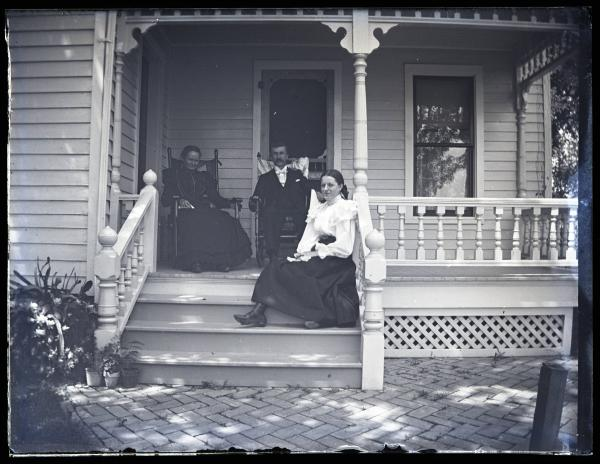 Minnie Stecher and Kinleys on front porch