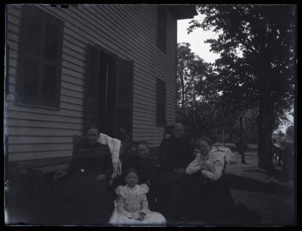 Group portrait by house