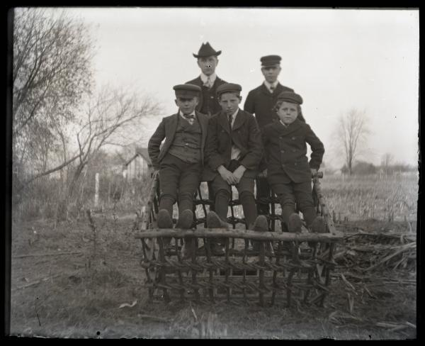 Boys in crate at Stecher's photograph