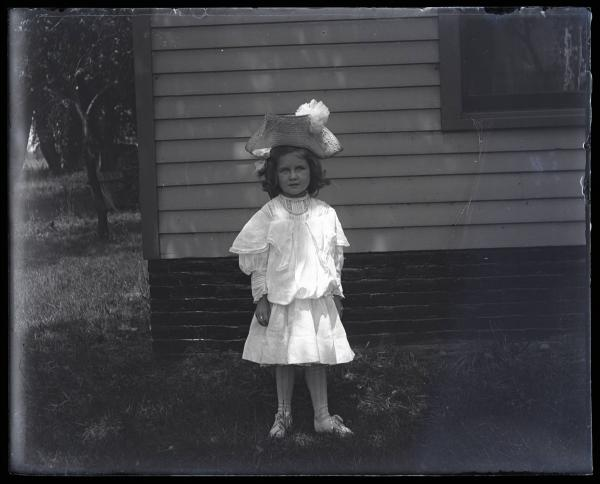 Young girl wearing large hat photograph
