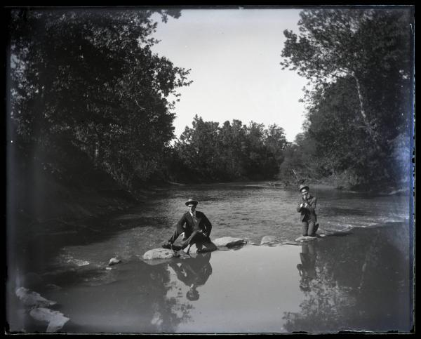 Two men on stepping stones