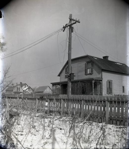Electric pole with broken cross arm photograph