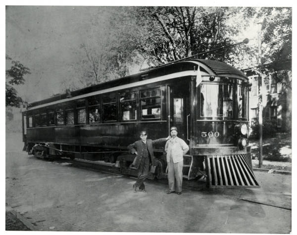 Interurban railroad car and conductors