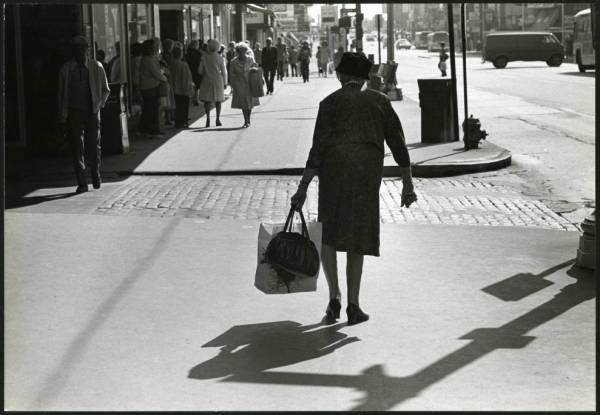 Woman with shopping bag photograph