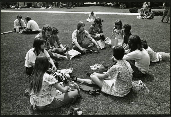 Young people relaxing on Statehouse lawn