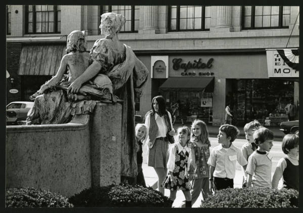 Children looking at statue