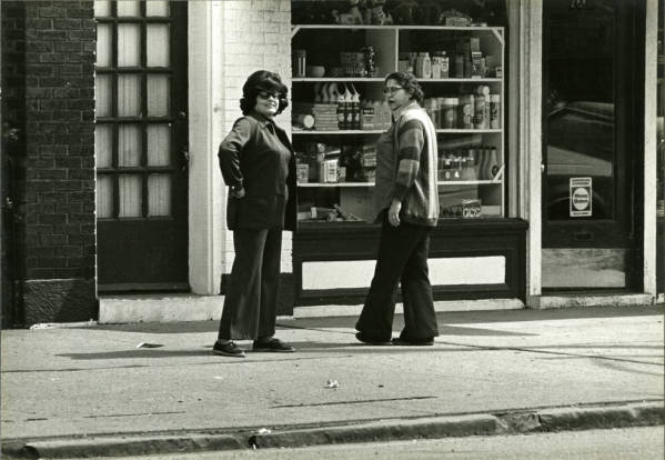 Two women speaking along High Street