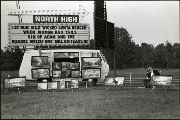 Man selling art at North High Drive-In