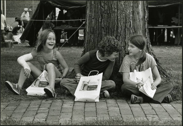 Three children near tree photograph
