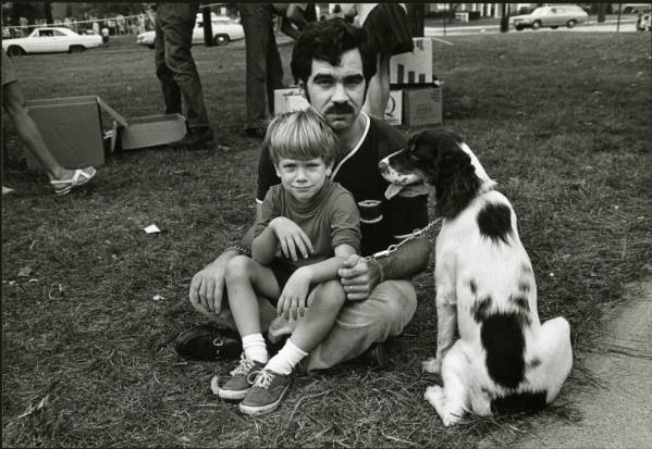 Father with son and dog photograph