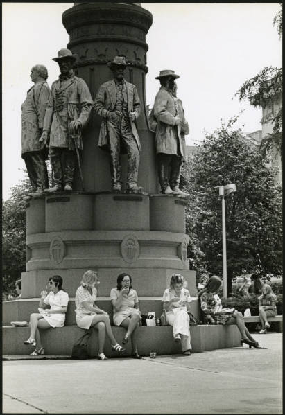 Women seated around 'These Are My Jewels' statue