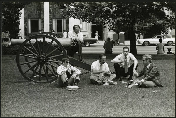 Five men eating lunch on Statehouse lawn