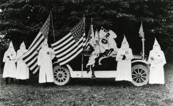 Klansmen with decorated parade car