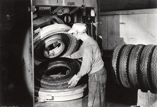Goodyear Tire and Rubber Company Employee Making Tires photograph