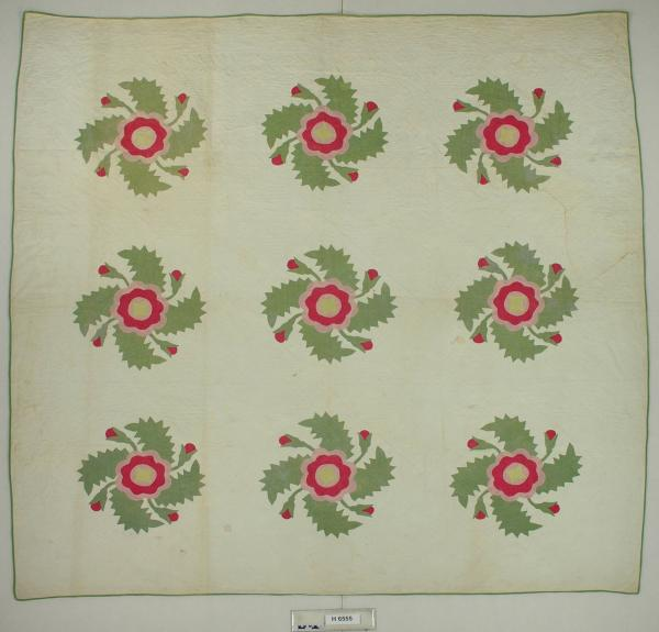 Appliqued Red and Green Quilt
