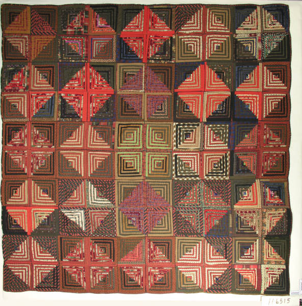 Log cabin patterned quilt