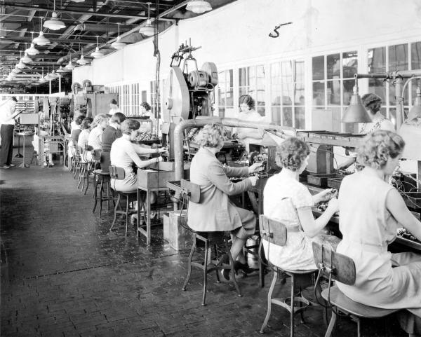 Women workers making spark plugs photograph
