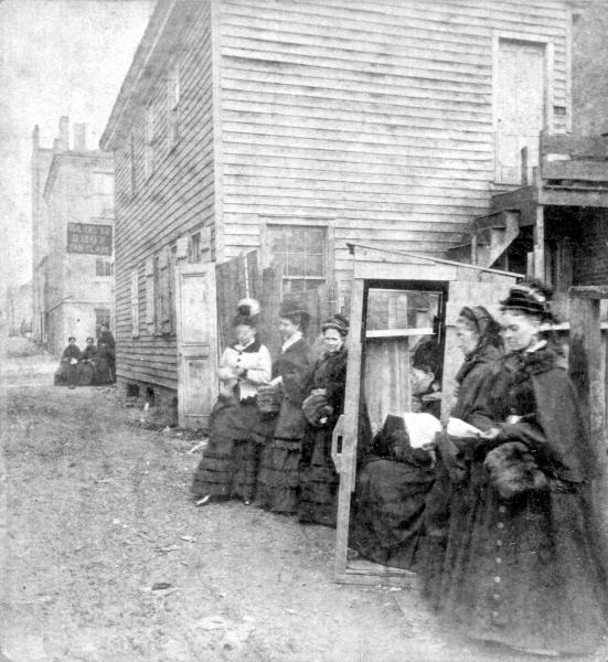 Women picketing rear of saloon photograph