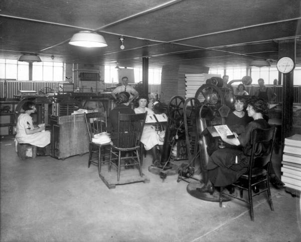 Women seated at printing presses