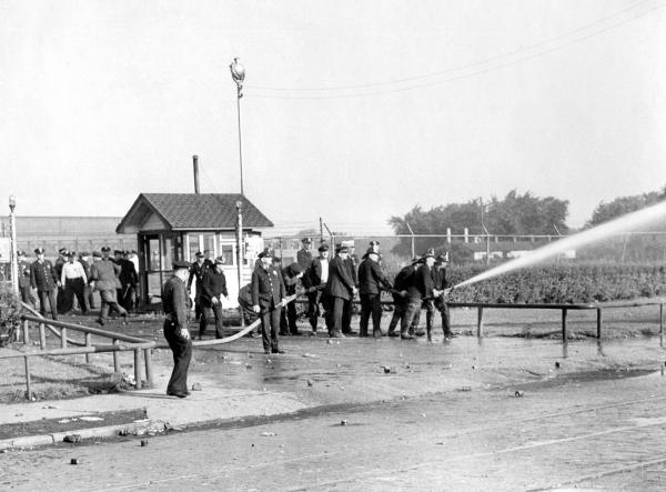 Police and Firemen Using High-Pressure Water Hose Against Strikers