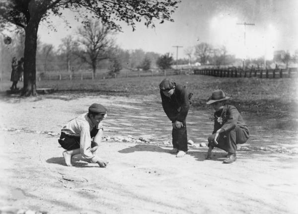 Boys playing marbles photograph