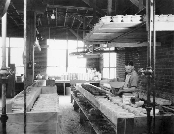 Salem China Company Employee Pouring Clay into Molds