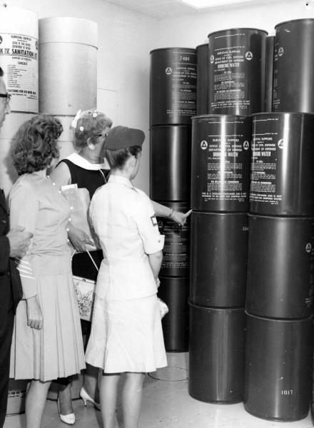 Inspection of survival supplies in public fallout shelter photograph