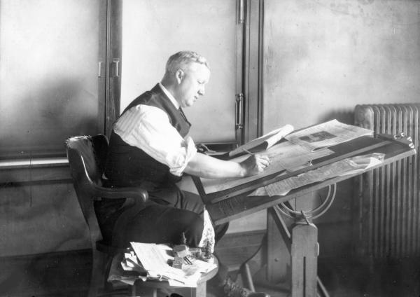 Billy Ireland at desk