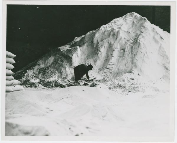 Man in a chemical storehouse