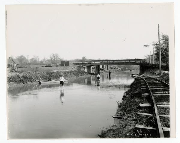 People wading in Miami and Erie canal in Dayton, Ohio