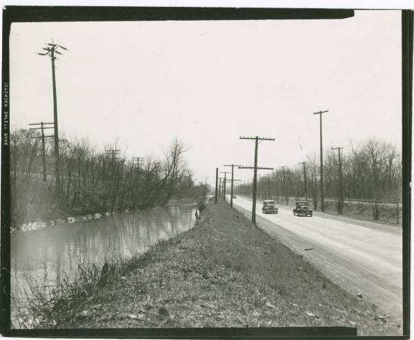 Cars driving along the Miami and Erie Canal photograph