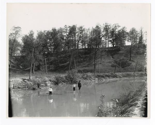 People wading in canal near Dayton, Ohio