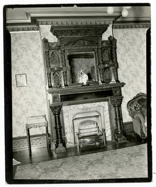 Fireplace with carved wood mantel