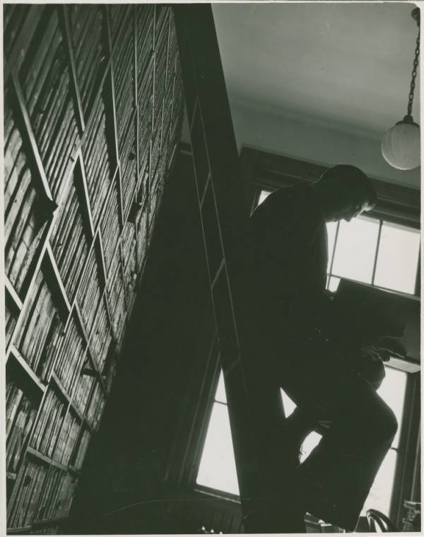 Ohio State University Library stacks - student on ladder
