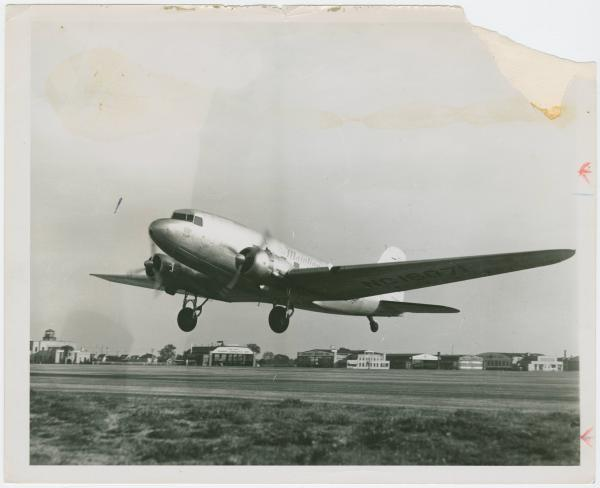 Airplane taking off at Clevelend Municipal Airport photograph