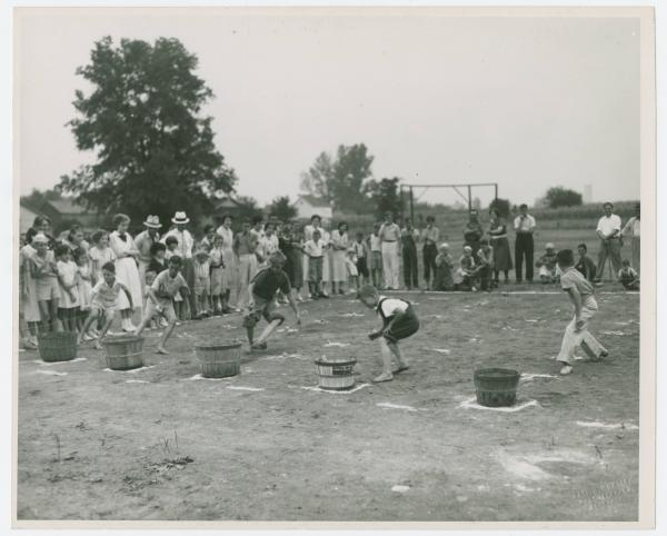 Potato race at Centennial Celebration photograph