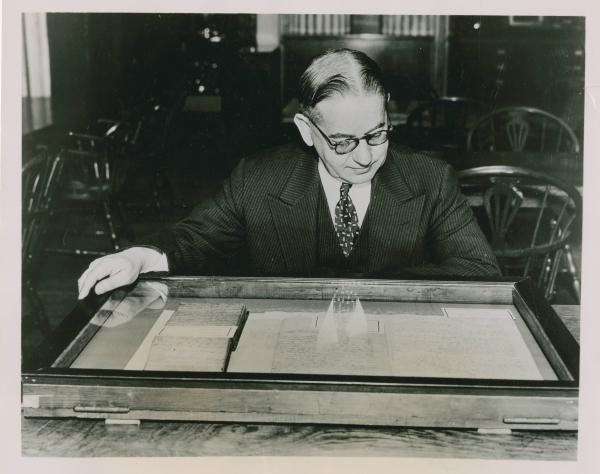 Man reading preserved document