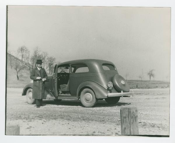 Miamisburg Mound with man and car