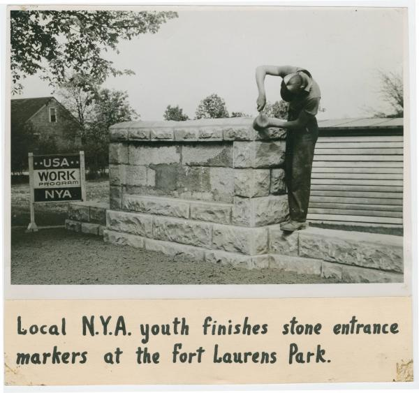NYA worker finishing stone entrance at Fort Laurens park